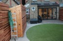 circular lawn and hidden shed